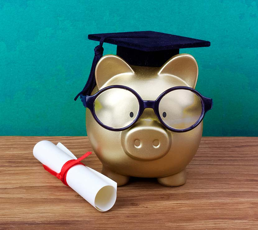 Gold piggy bank with graduate hat and glasses